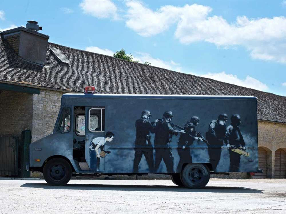 https://www.artsandcollections.com/wp-content/uploads/2018/08/Banksys-SWAT-Van.jpg