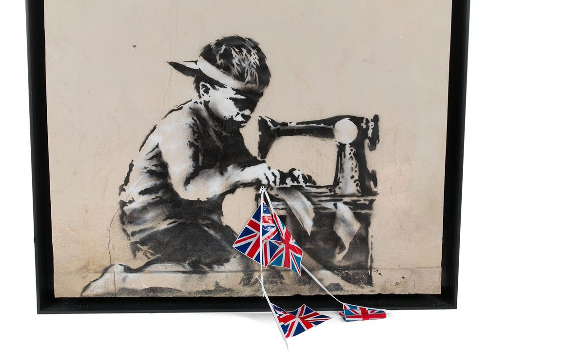 https://www.artsandcollections.com/wp-content/uploads/2018/11/Artist-Buys-Banksy's-'Slave-Labour'-To-Whitewash-It-1200x720.jpg