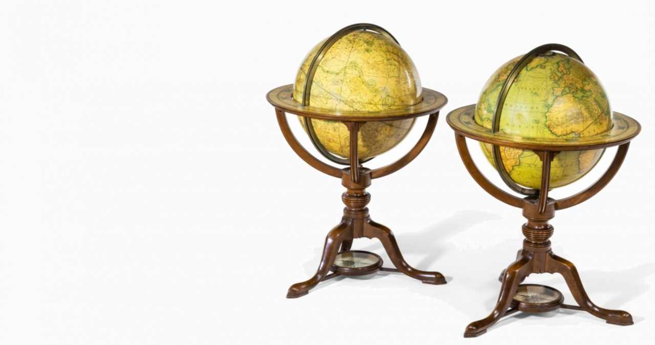 https://www.artsandcollections.com/wp-content/uploads/2019/12/Wicks-Antiques-_-A-PAIR-OF-CARYS-12-INCH-LIBRARY-TABLE-GLOBES-IN-MAHOGANY-STANDS-edit-1280x674.jpg