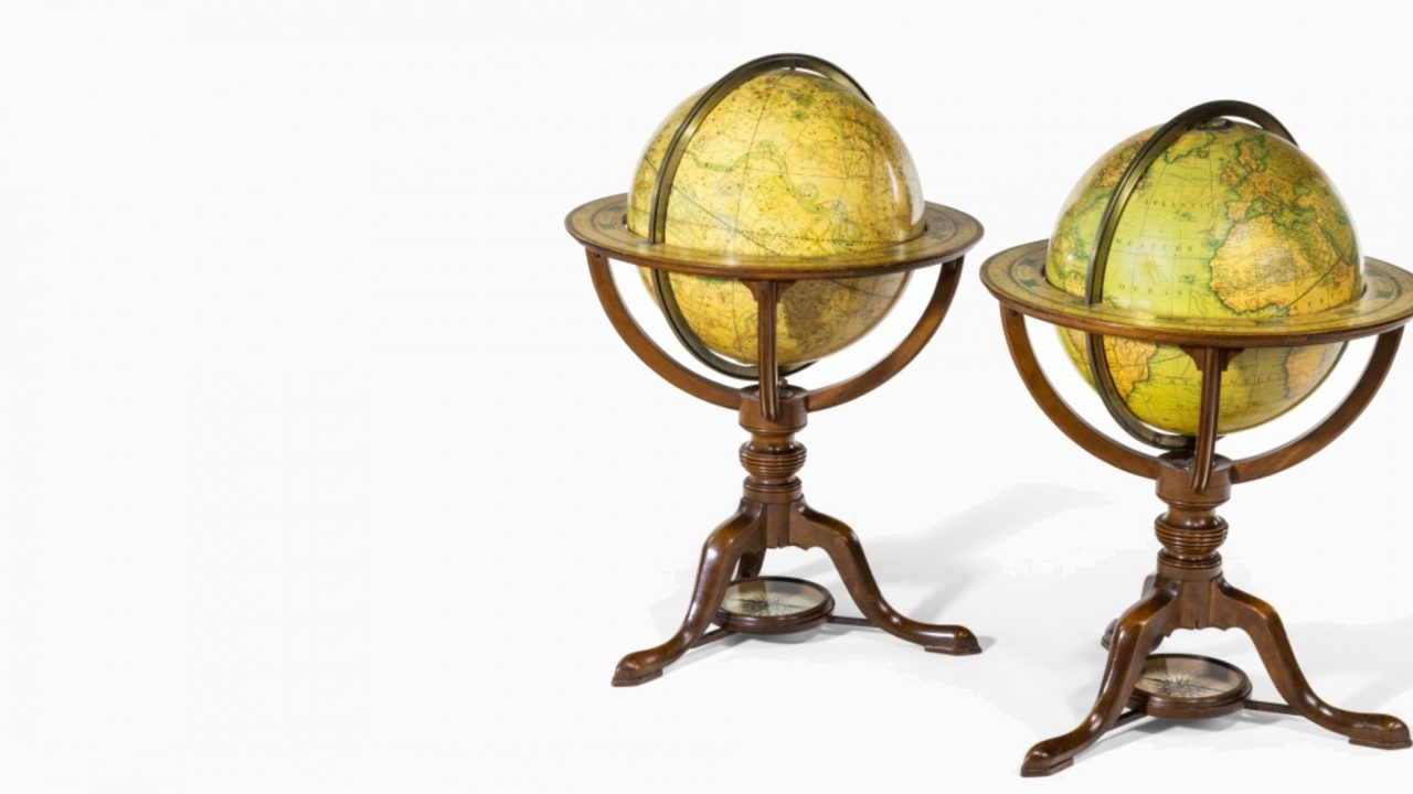 https://www.artsandcollections.com/wp-content/uploads/2019/12/Wicks-Antiques-_-A-PAIR-OF-CARYS-12-INCH-LIBRARY-TABLE-GLOBES-IN-MAHOGANY-STANDS-edit-1280x720.jpg